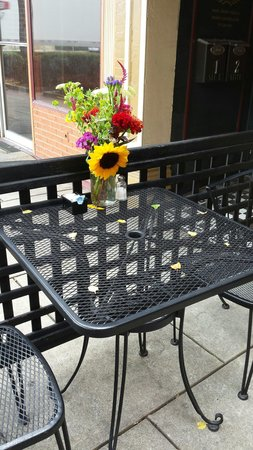 Cafe D'italia: They place fresh flowers out every week and at the end of the week if they can they find people