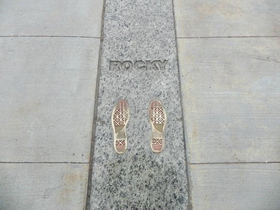 Rocky Statue : Rocky footprints imprinted into the ground at the top of the steps.