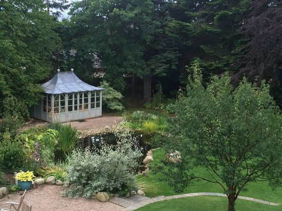 The Dulaig: View of the garden and summer house from our room