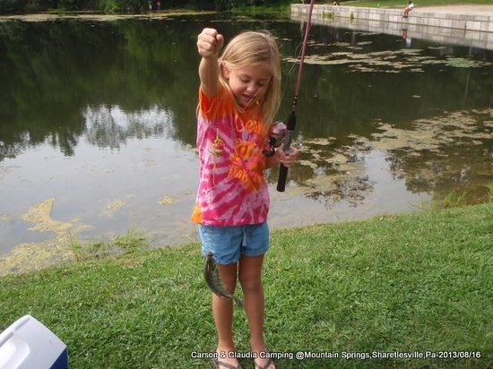 Mountain Springs Camping Resort: Claudia fishing for first time.