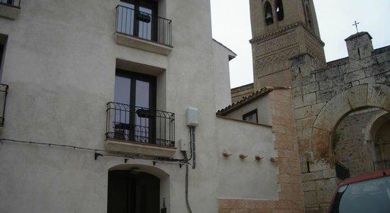 apartamentos rurales la fonda: Hotel façade, next to church