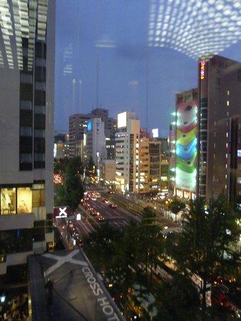Cross Hotel Osaka : Looking out the glass elevator. Logo below.