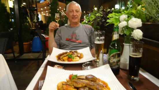 Evidens Bistro : With pear Palinka and goose liver