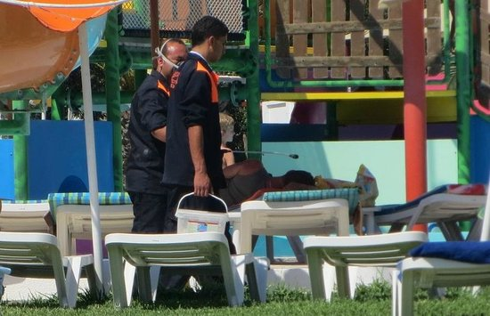 Thalassa Sousse Resort & Aquapark: Spaying insect killer between loungers,they have masks while they spray inches from guests