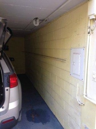 Days Inn & Suites Islamorada : raw sewage leaking on us and our car from bath above carport
