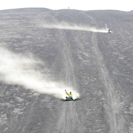 Cerro Negro Volcano: boarding down holding GoPro
