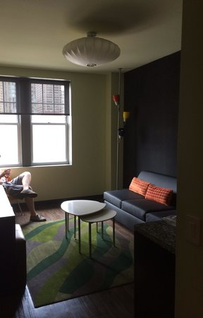 ACME Hotel Company Chicago: View of living room in the king suite of rm 1402 as seen from the front door to your right