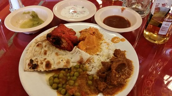 Taj Mahal: indian sauces w/tikka grilled chicken, curried goat n peas, rice naan
