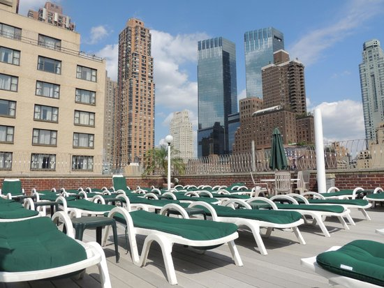 The Watson Hotel: Rooftop plaza adjacent to pool facing the north tower.