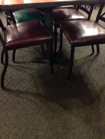 Golden Corral: A picture of under one of the tables - looks like it's been left all day without being swept!
