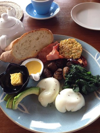 Shelter Bali: Big Shelter Breakfast - sourdough bread, two eggs, smoked bacon, spinach, mushroom, rosti & avoc