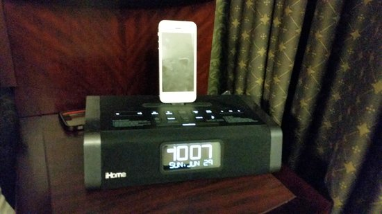 Club Quarters Hotel in Boston: Ipod docking station and alarm clock, with plenty of other plug ins for working guests, Club Qua