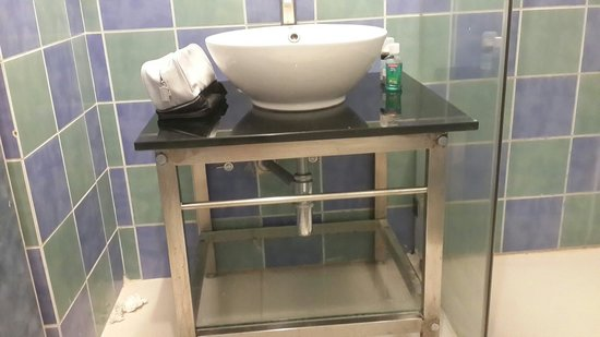 Aditya Hometel : Wash basin is placed on a stool like structure. No dustbin so you have to throw tissue on the fl