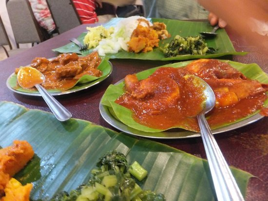 Jothy's Fish Head Curry and Banana Leaf Restaurant: Lamb masala on left and Prawn sambal on right