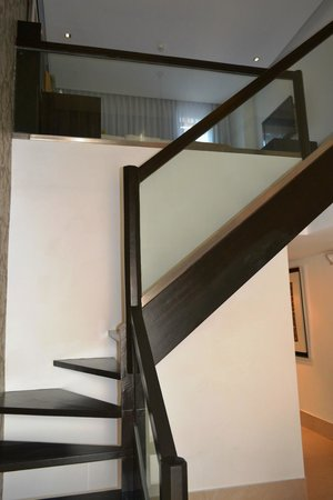 The District Boracay: Stairs leading to the bedroom upstairs