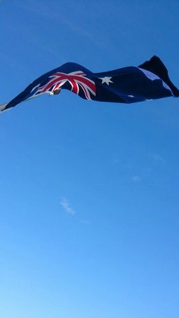 Cairns Harbour Cruises: Fly flag, flag fly (on the rare end of the boat)