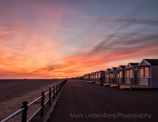 St. Annes Beach Huts: A view fo the Beachhuts during Sunset