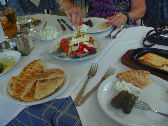Arsenis Taverna Iseris : greek salad, saganaki, taziki and pita, wine leaves