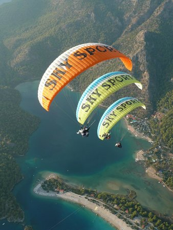 Fly over the paradise with sky sports paragliding