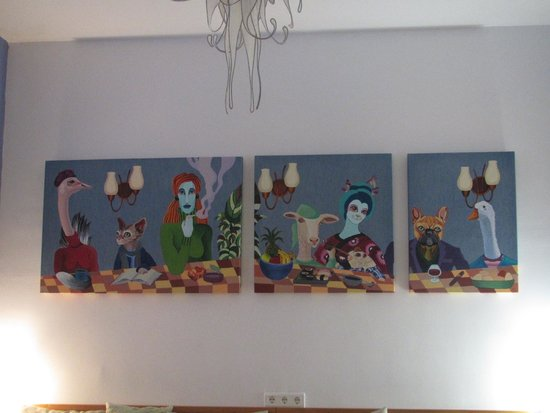 Villa Alicia Guest House: Quirky Paintings on the wall of the Reception Area
