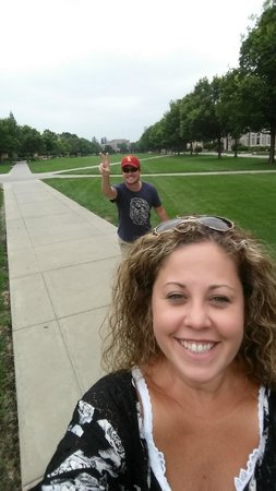 Morris Inn : My USC husband photo bombing is ND wife near the front of South Dining Hall