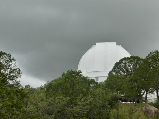 McDonald Observatory: The huge telescope against a cloudy sky is lovely.