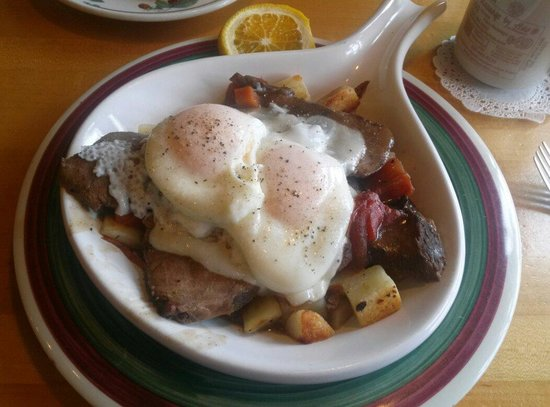Egg'lectic Cafe: The Dutch Pot Roast Skillet with poached eggs. Vey good!