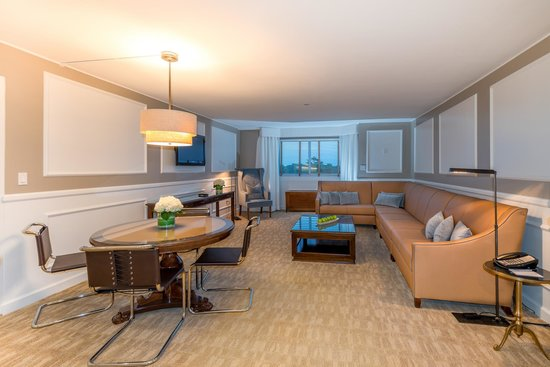 Garden City Hotel: A Deluxe Suite Parlor, with dining area and wet bar