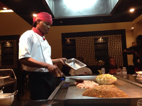 Secrets Wild Orchid Montego Bay: Marlon, whipping up a Japanese meal while singing
