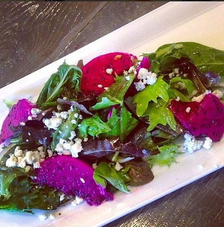CROSSINGS: Mixed local greens salad, crumbled blue cheese, dragon fruit, passion fruit vinaigrette
