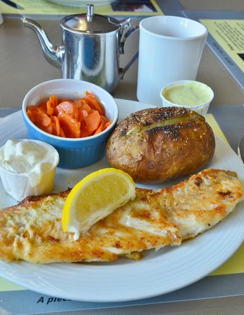 Cafe l'Acadie: Fresh haddock done just right with homemade marinated carrots and tartar sauce...
