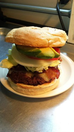 Have A Nice Day Cafe: Bacon Avocado Burger. Comes with choice of side