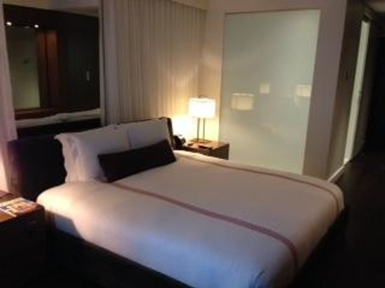 Thompson Toronto - A Thompson Hotel: the shower is to the left of the bed (separated by frosted glass window)