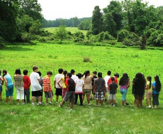 Jay Heritage Center: School Children Looking out at Long Island Sound and the oldest Man Managed Meadow in NY State