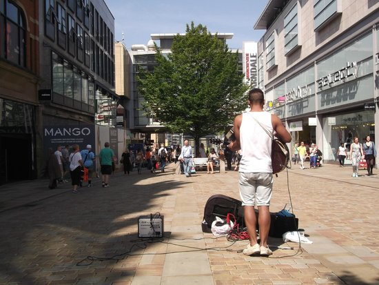 Market Street: Busker singing and playing guitar