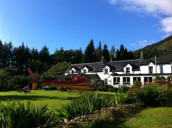 The Brander Lodge Hotel & Bistro: Back Garden with Scottish blue sky