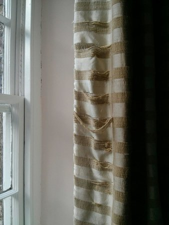 Tredethy House: Old worn curtains