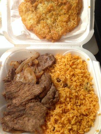 Sofrito Mama's: Bistec encebolla, arroz con gandules, and bacalaito