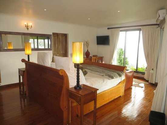 Boutique @ 10: Ocean Suite sleigh bed now central with view of beach and ocean ...