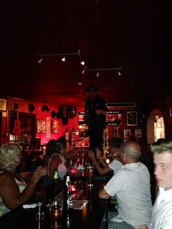 Johnny Hooper's Saxophone Bistro : Johnny on the table giving it soul!