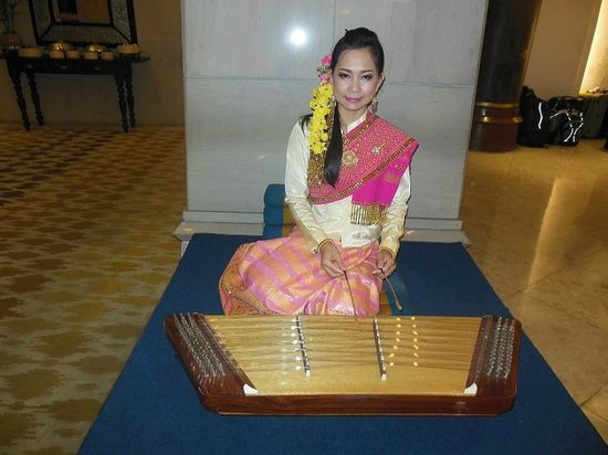 Local artist performing in the foyer of the Imperial Mae Ping Hotel