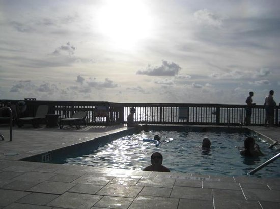 Lime Tree Bay Resort: The pool deck with the sun setting