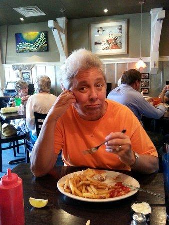 Fish Bites: Jean ejoying her Cod Fish! She's camera shy..lol