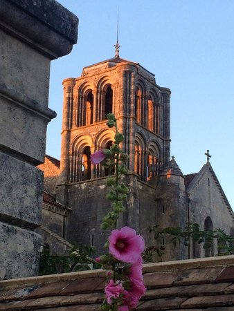 La Maison du Visiteur : The evening light on the Basilica