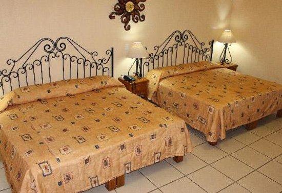 Hotel Hacienda del Sol: habitacion con 2 camas matrimoniales