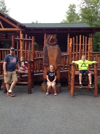 Adirondack Extreme Adventure Course: The family posing with the big chairs & bear before getting ready to gear up!