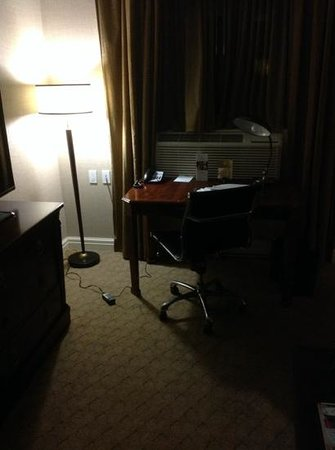 The Lord Nelson Hotel & Suites: desk and work area and TV.