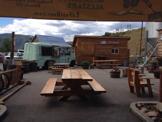 Crazy Mountain Brewing Company : Looking out onto the food truck and outdoor eating area.