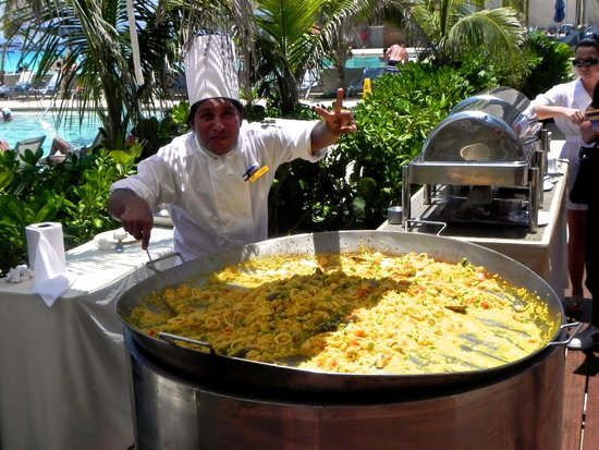 Secrets The Vine Cancun: Paella cooked poolside.