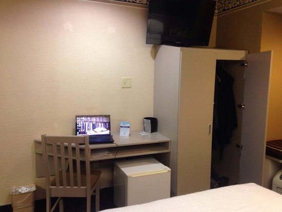 Microtel Inn & Suites by Wyndham Houston : A mini-fridge under the desk doesn't make for a ton of leg room to get any work done.